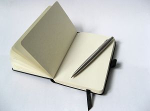 black-notebook-with-pencil-1176000-m
